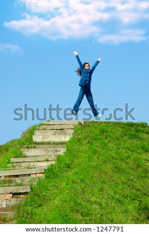 Young woman jumping from joy