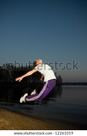 Young woman jumping in a beach