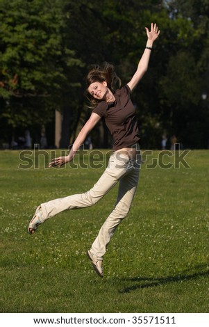 Young woman jumping in the park