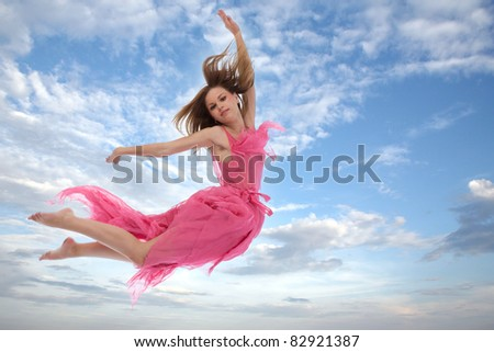 young woman jumping in the sky