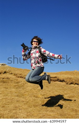 young woman jumping on a grass