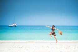 Young woman jumping on the beach at kho maiton Phuket, Summer Relaxing Concept.