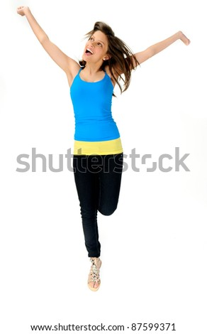 young woman jumps for joy in studio, happy and fresh