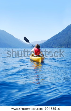 Young woman kayaking on Lake Crescent, Olympic National Park, Washington, USA