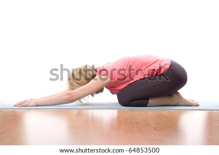 Young woman kneeling making gym over white