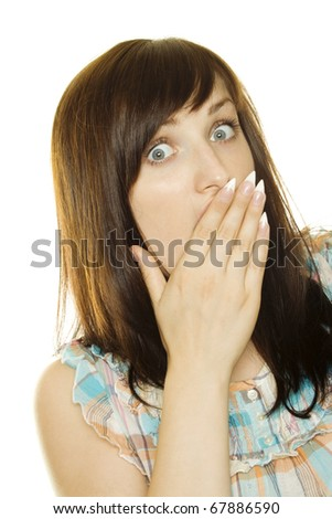 Young woman laughs and covers her mouth with his hand