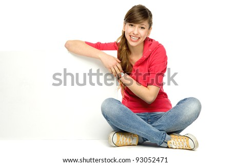 Young woman leaning on blank poster