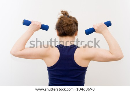 young woman lifting a weight