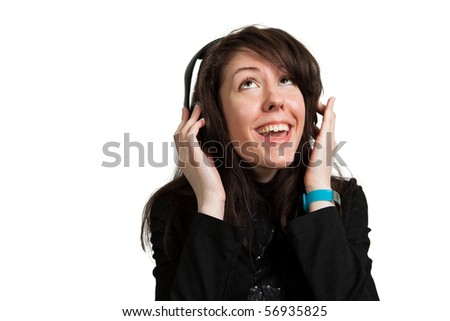 Young woman listening music and singing