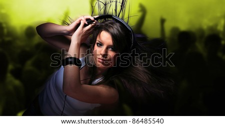 young woman listening music at disco or a night club