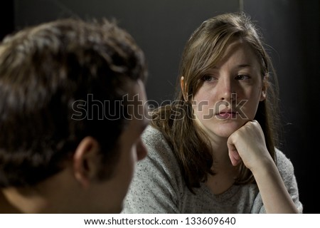 Young woman listening to man's testimony at a support group