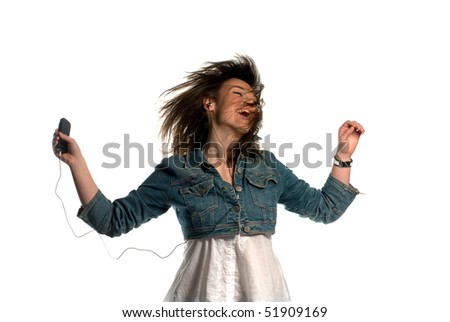 Stock Photo Young woman listening to music and dancing isolated on white