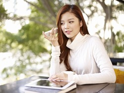 young woman listening to voice message using mobile phone.