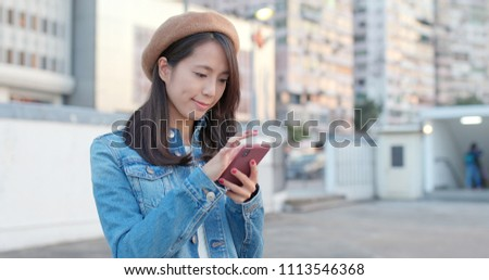 Young woman look at cellphone for online