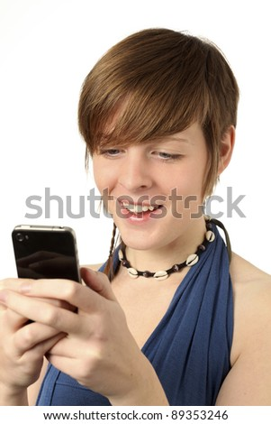 young woman looking at a message on a smart phone