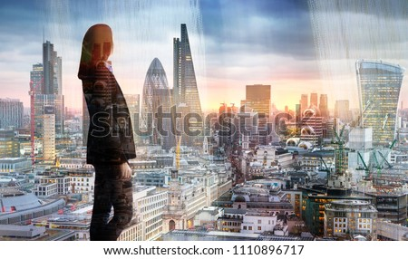 Young woman looking at the City of London, financial district. Early morning. Sun rise. Future, planning and business progress concept. #1110896717
