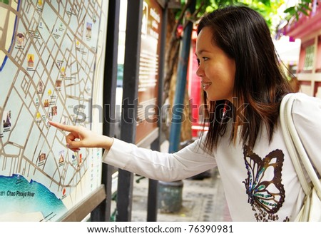 young woman looking at the map