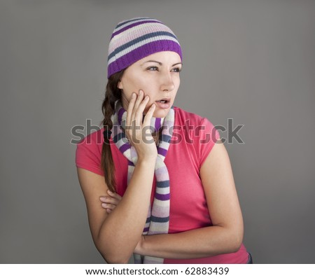 Young woman looking enviously