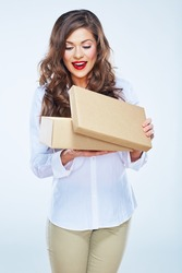 young woman looking into open box. Long curly hair. Beautiful female model.