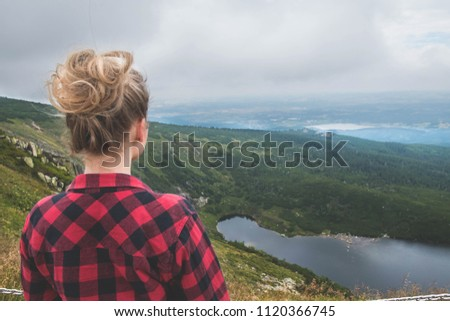 Young woman looking over lake and mountains in Poland Zdjęcia stock ©