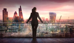 Young woman looking over the City of London business and banking aria with skyscrapers at sunset. Future, new business opportunity, freedom and stability. London, UK