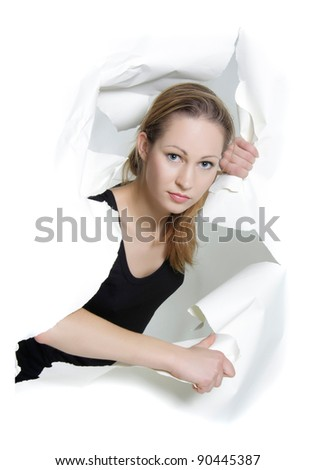young woman looking through hole in paper