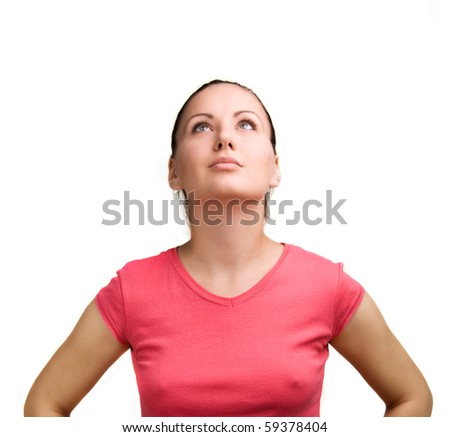 Young woman looking up above. Isolated against white background