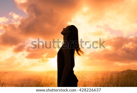 Young woman looking up into the sky. Stress free concept.