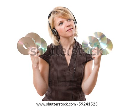 young woman looking up with cds in the hands