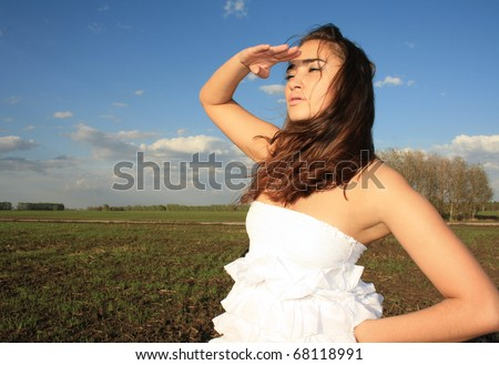 Young woman looks afar