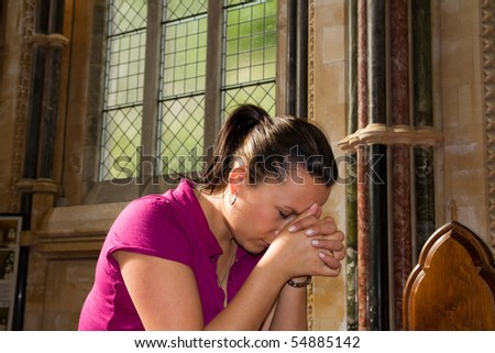 Young woman lost in pray