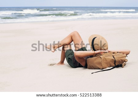 Stock Photo Young woman lying on a beach. Relaxation concept