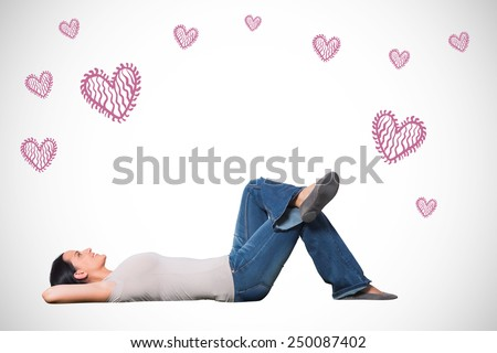 Young woman lying on floor thinking against white background with vignette