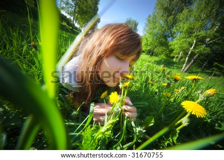 Young woman lying on grass. Wide angle view.