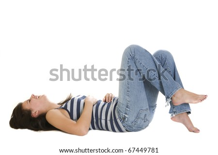 Young woman lying on her back laughing