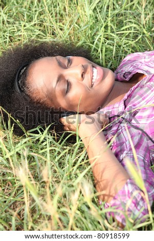 young woman lying on the grass