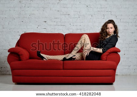 Sexy red haired woman on couch