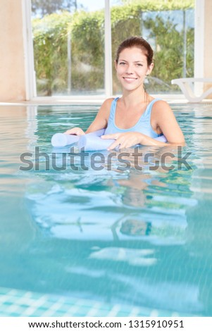 Young woman makes hydrotherapy in the spa pool of the spa hotel
