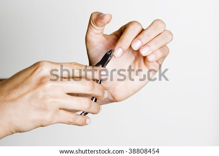 Young woman making manicure