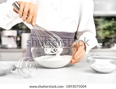 Young woman making whipped cream. Delicious food concept. Great design for any purposes. ストックフォト ©