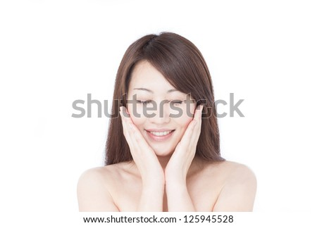 young woman massaging her face, isolated on white background