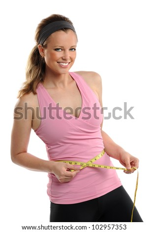 Young woman measuring waist with tape isolated over white background