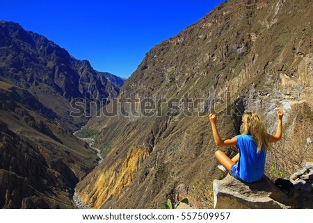 young woman meditate above the...