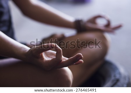 Young woman meditating indoors