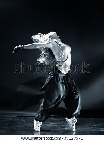 Young woman modern dance. Dark blue tint.