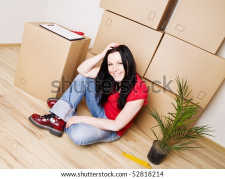 young woman moving to new house