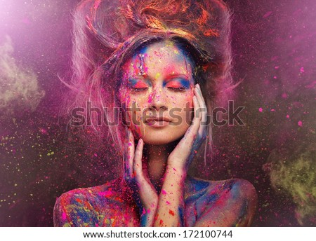Stock Photo Young woman muse with creative body art and hairdo