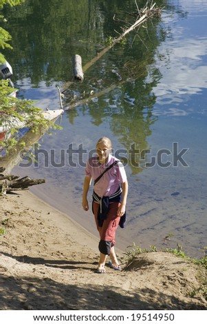 Young woman on a lakeshore in Canada