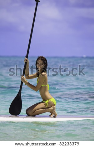 young woman on a stand up paddle board