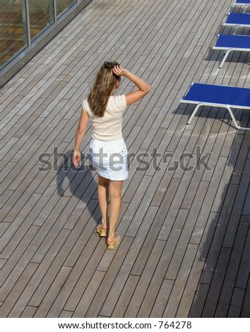 Young woman on a stroll - stock photo